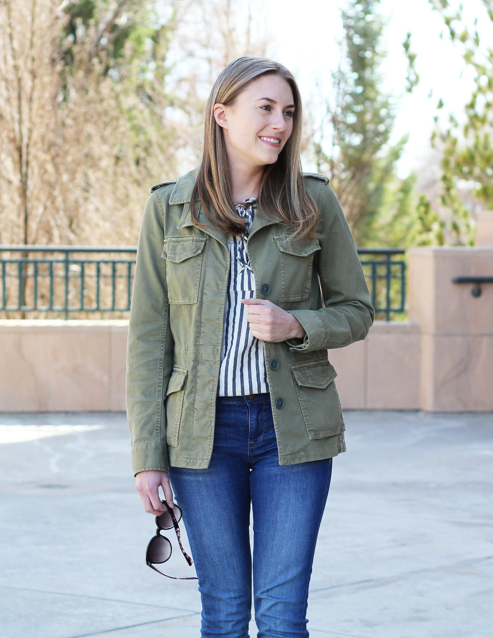 Striped lace-up top outfit with utility jacket and skinny jeans — Cotton Cashmere Cat Hair