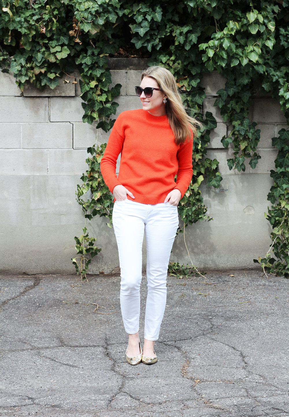 Bright spring outfit with red sweater, white denim, gold flats — Cotton Cashmere Cat Hair