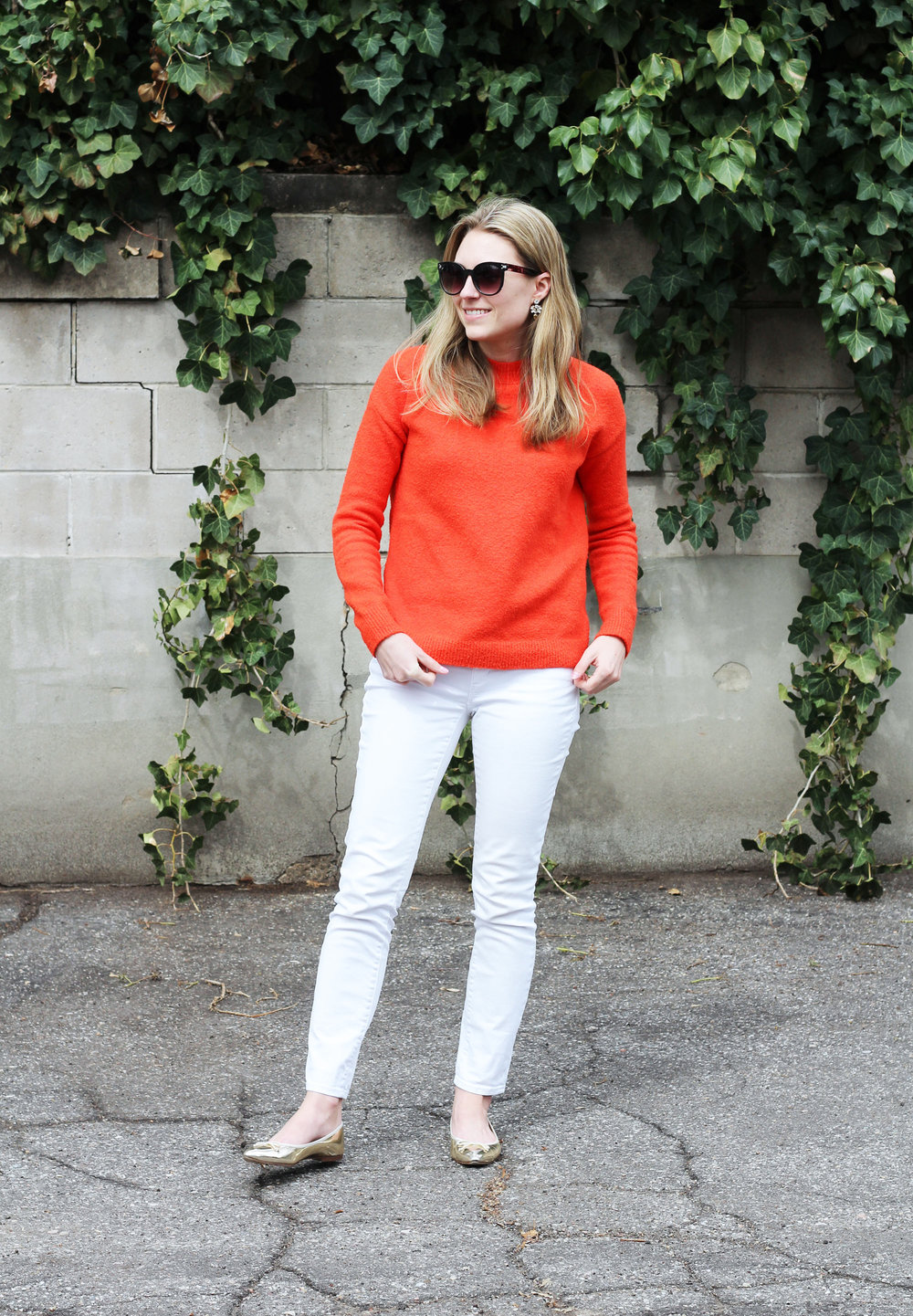 Bright red sweater outfit with white skinny jeans and gold flats — Cotton Cashmere Cat Hair
