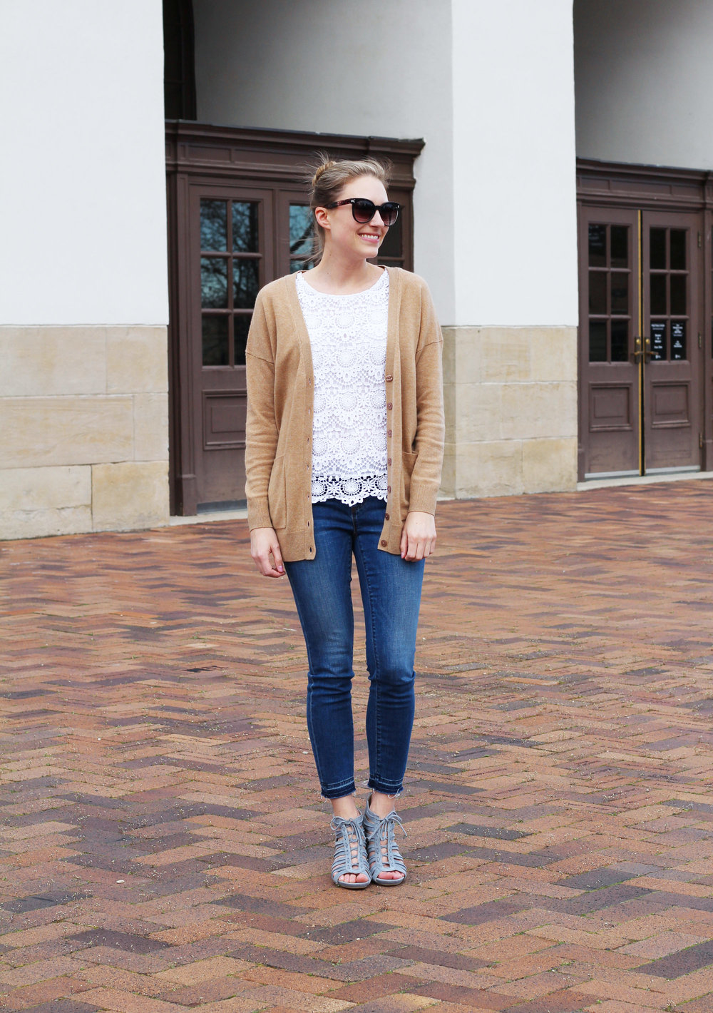 Camel cardigan outfit with white lace top, skinny jeans, light blue sandals — Cotton Cashmere Cat Hair