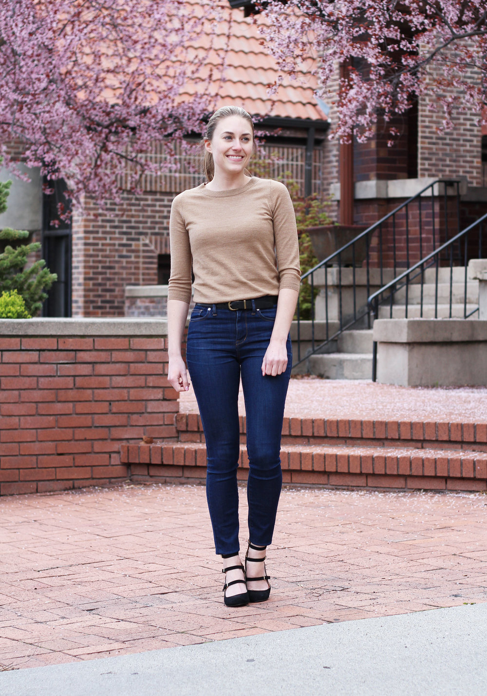 Work outfit with camel sweater, high-rise skinny jeans, strappy heels — Cotton Cashmere Cat Hair