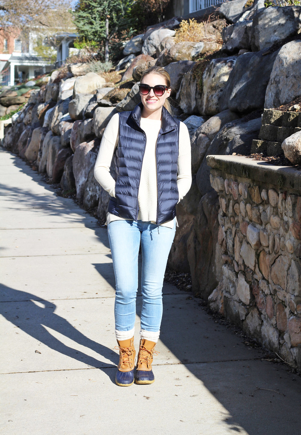 Navy vest outfit with ivory sweater, light wash denim, navy Bean boots — Cotton Cashmere Cat Hair