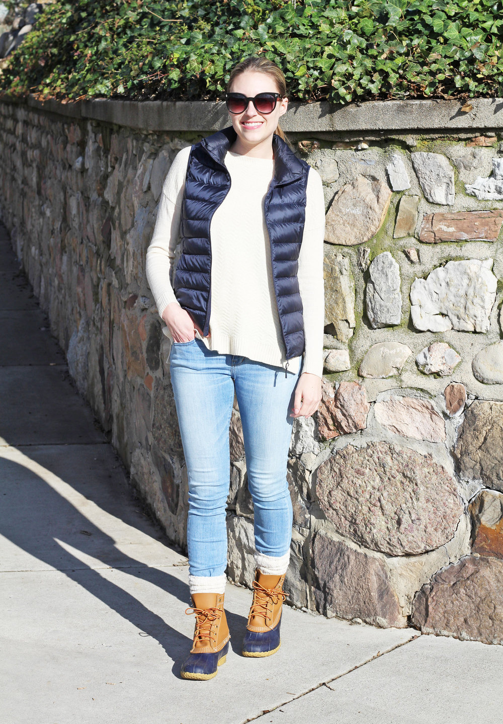 Navy Bean boots outfit with navy vest, ivory sweater, light wash denim — Cotton Cashmere Cat Hair