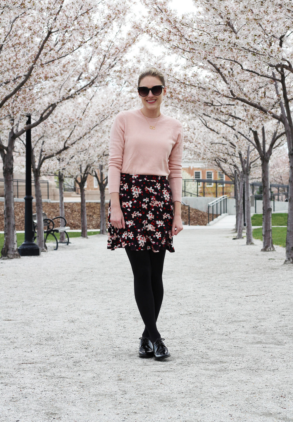 Dark floral mini skirt outfit with blush sweater and shiny black oxfords — Cotton Cashmere Cat Hair
