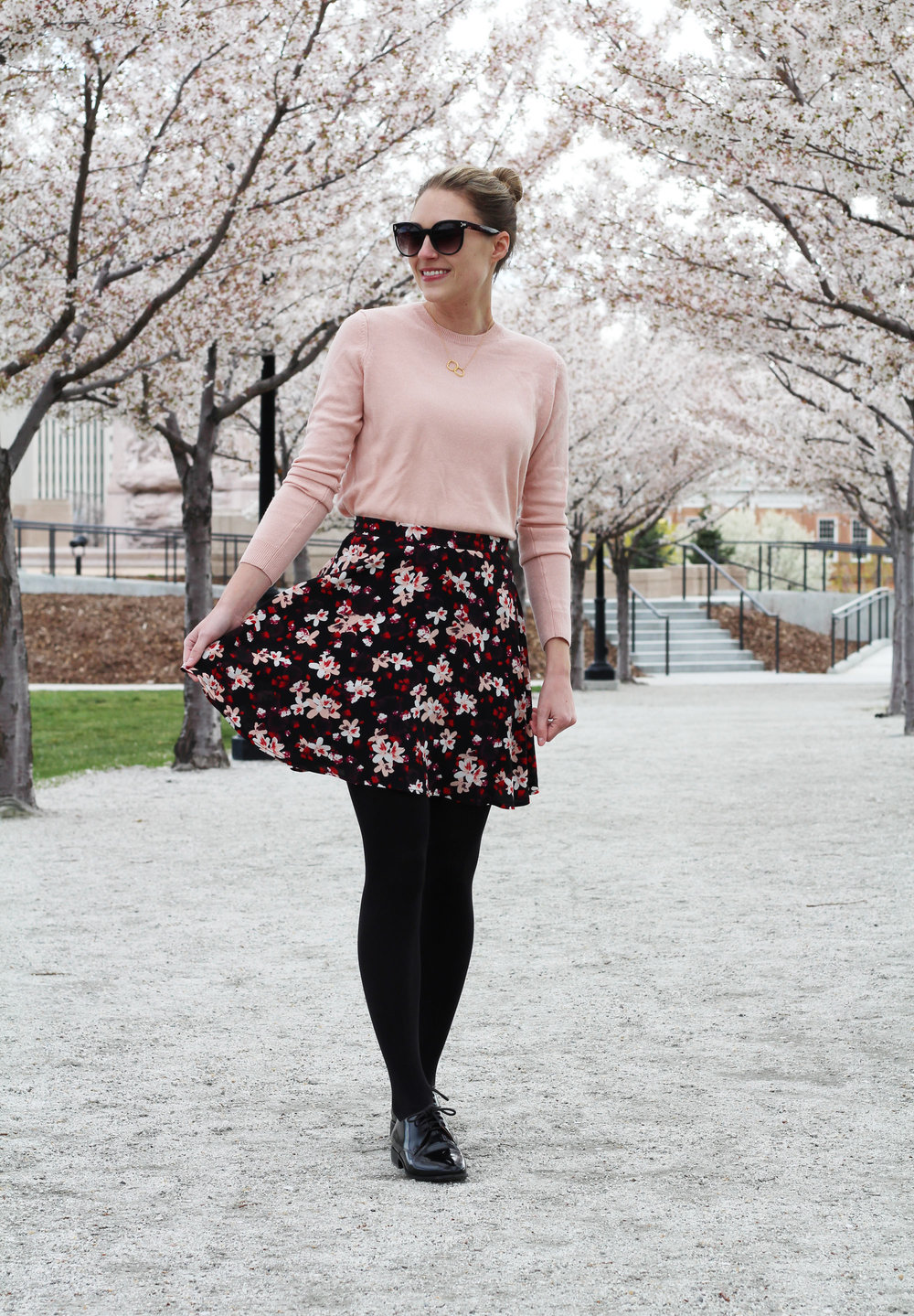 Spring outfit with blush sweater and black floral skirt — Cotton Cashmere Cat Hair