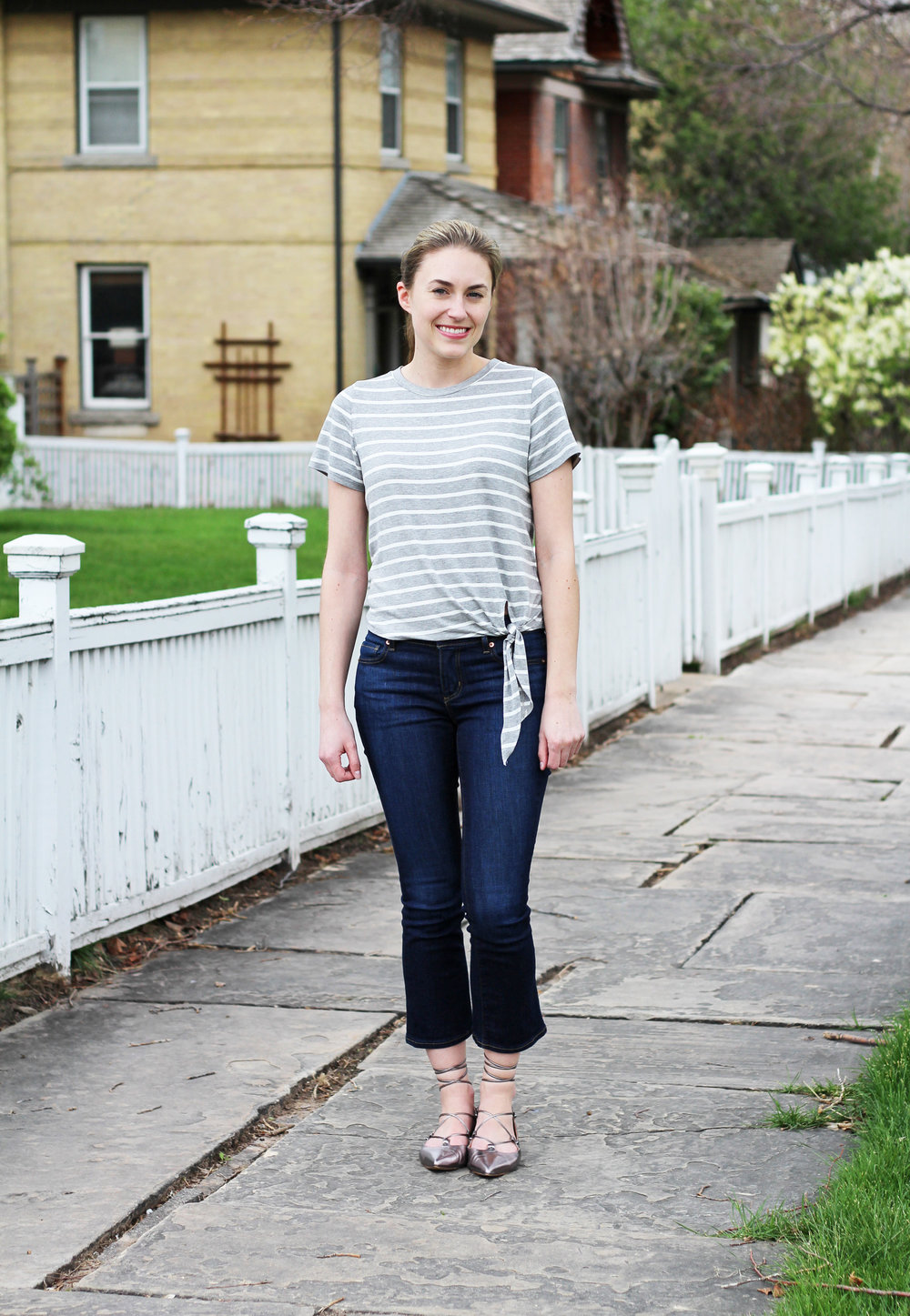 Striped side-tie tee outfit with cropped flare jeans and lace-up flats — Cotton Cashmere Cat Hair