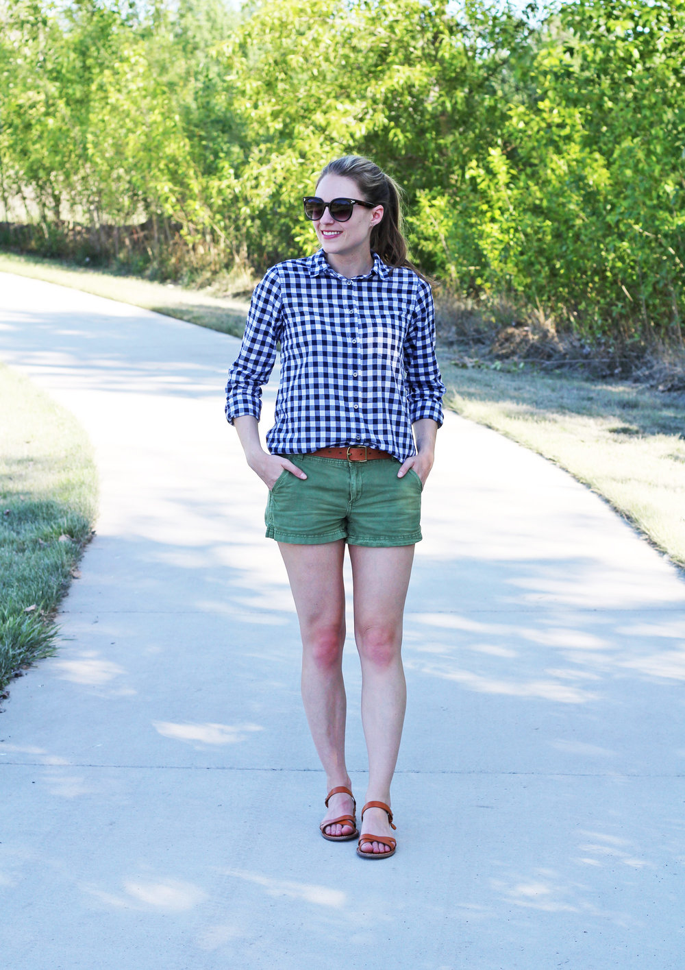 Navy gingham shirt outfit with green shorts and cognac sandals — Cotton Cashmere Cat Hair
