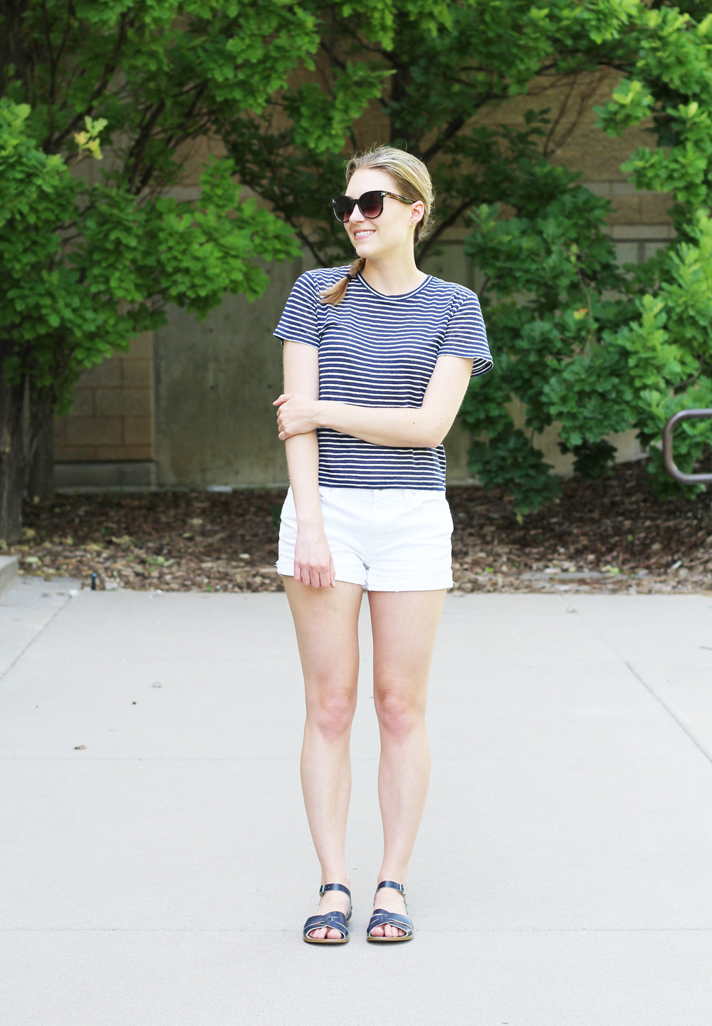 Striped indigo linen tee outfit with white denim shorts and navy sandals — Cotton Cashmere Cat Hair