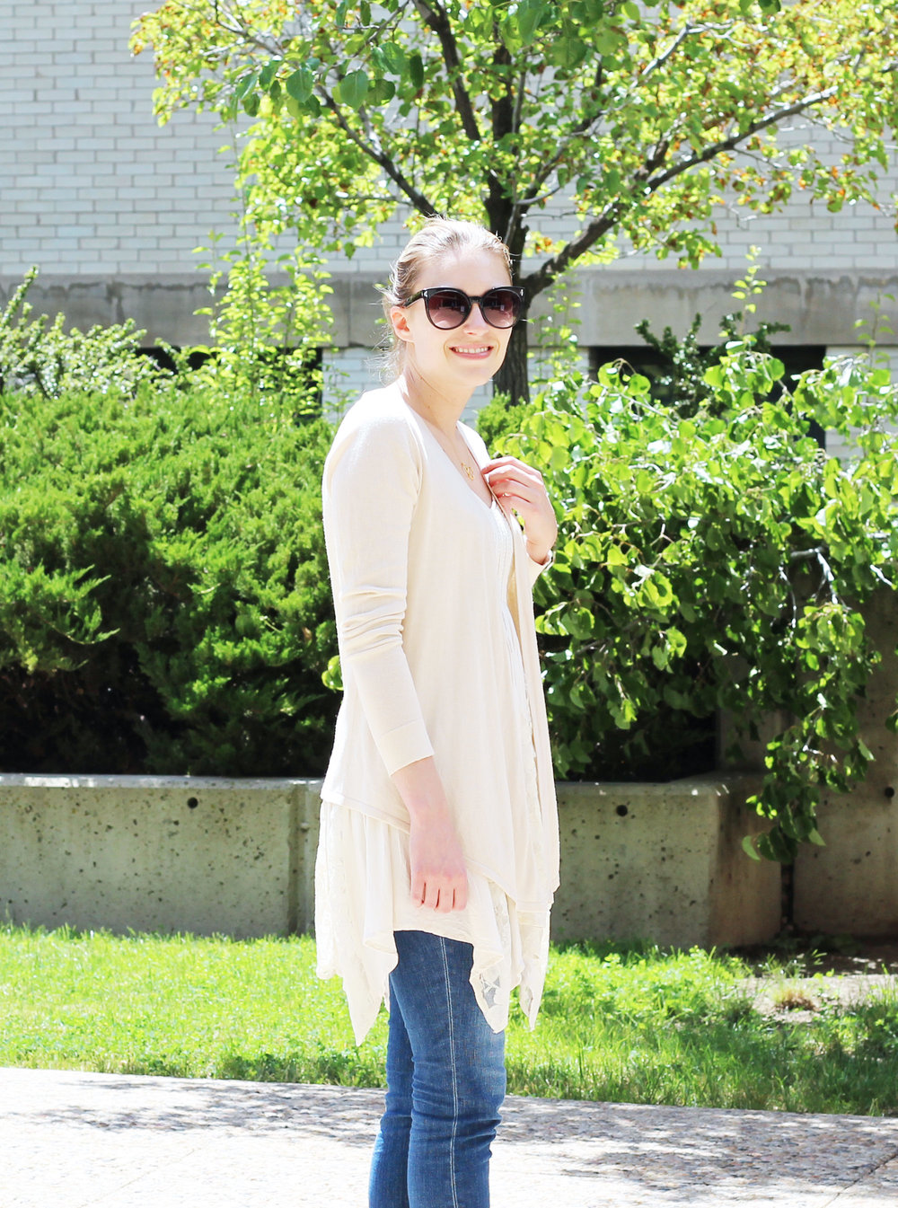 Cream cardigan layered over asymmetrical lace dress — Cotton Cashmere Cat Hair