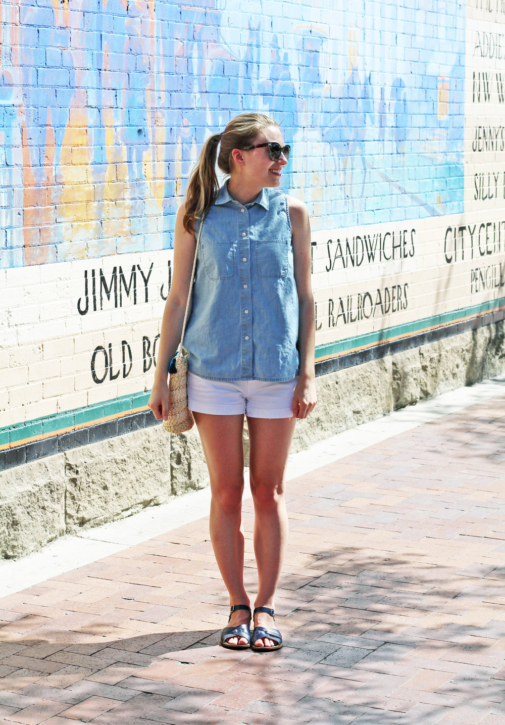Summer outfit with sleeveless chambray shirt and white denim shorts — Cotton Cashmere Cat Hair