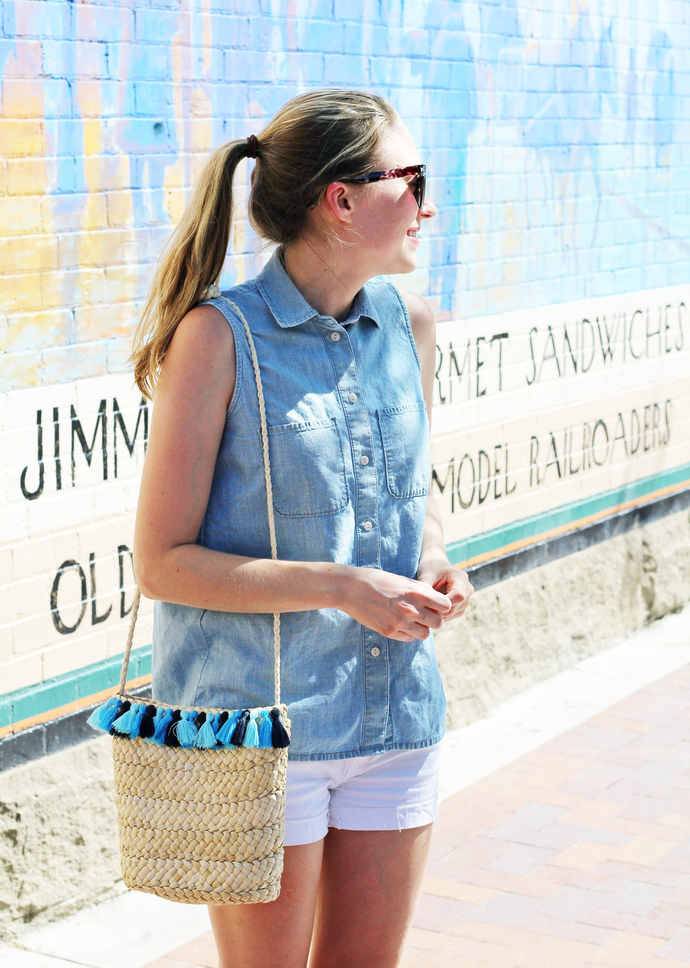 Blue tassel woven straw bag outfit with chambray shirt — Cotton Cashmere Cat Hair