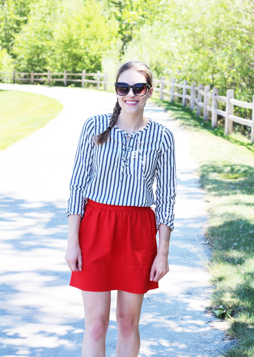 Red mini skirt outfit with striped lace-up top — Cotton Cashmere Cat Hair
