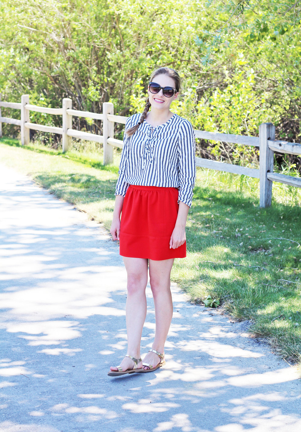 4th of July outfit with striped top, red skirt, gold sandals — Cotton Cashmere Cat Hair
