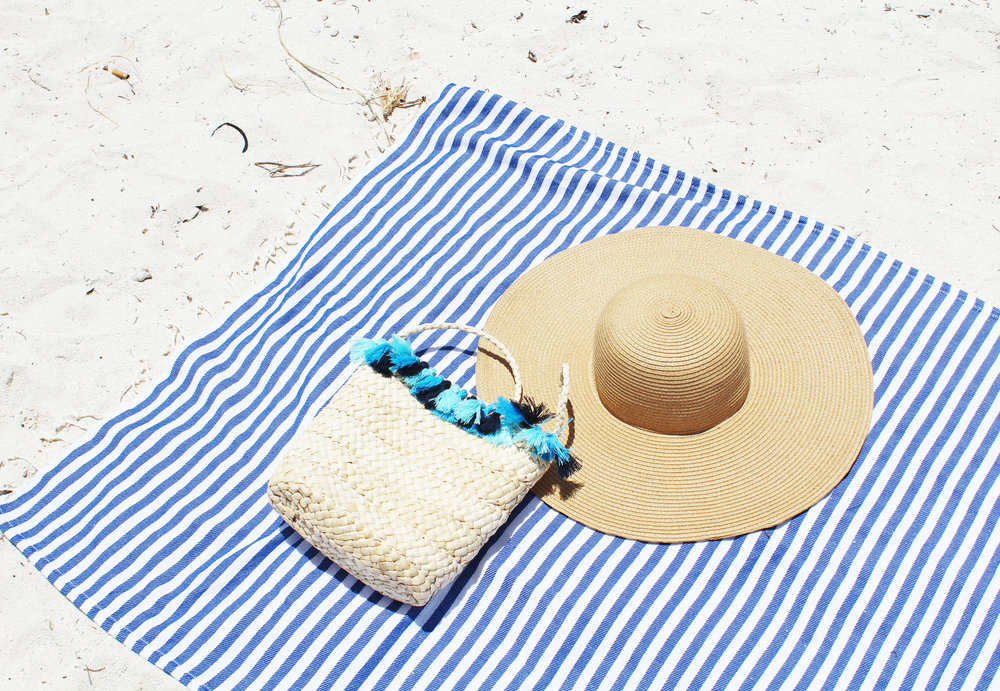 Beach essentials: straw bag + straw hat + striped towel — Cotton Cashmere Cat Hair
