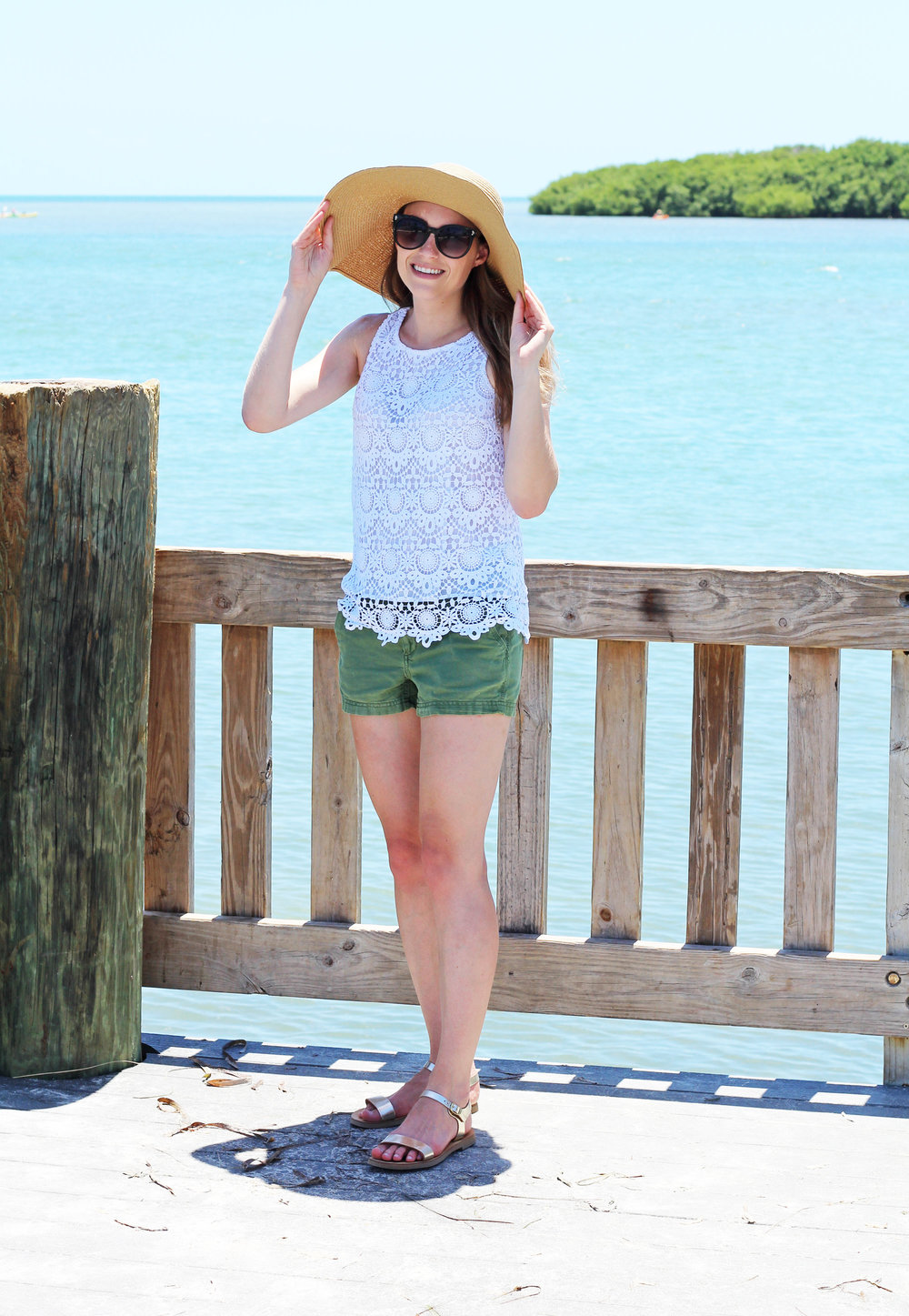 Green shorts summer outfit with white lace top and gold sandals — Cotton Cashmere Cat Hair