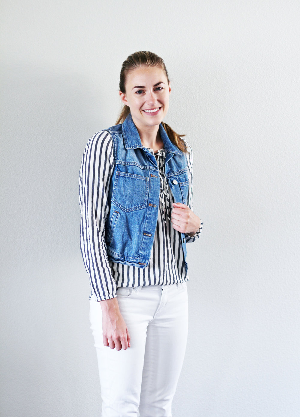 Double denim outfit with denim vest and white skinny jeans — Cotton Cashmere Cat Hair