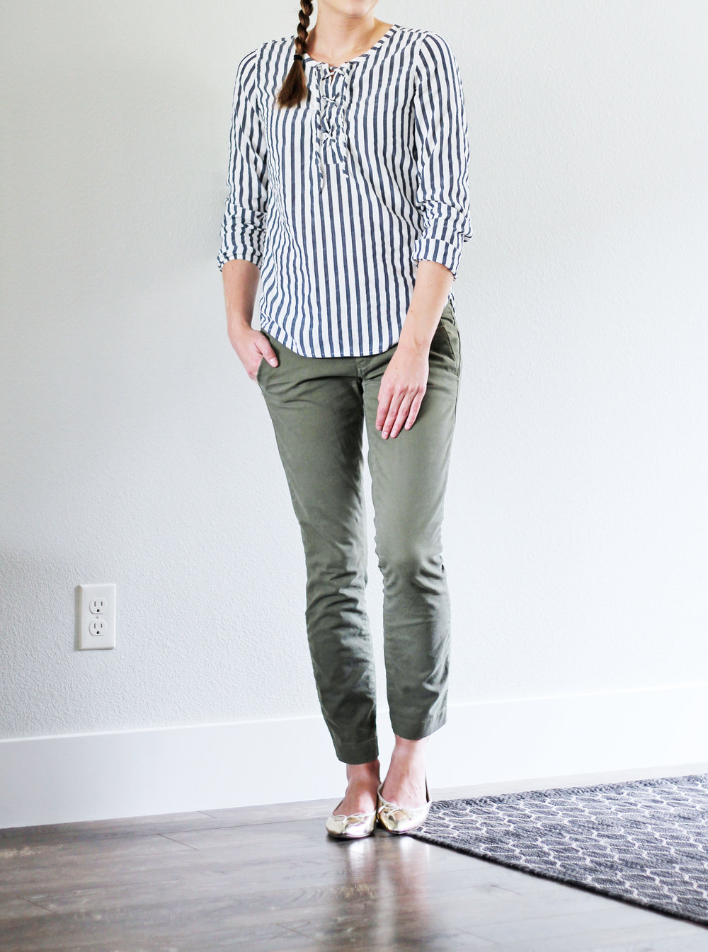 Blue striped lace-up top outfit with green chinos and gold flats — Cotton Cashmere Cat Hair