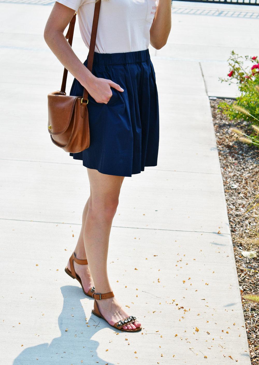 Navy cotton-poplin mini skirt with cognac sandals and vintage Coach bag — Cotton Cashmere Cat Hair