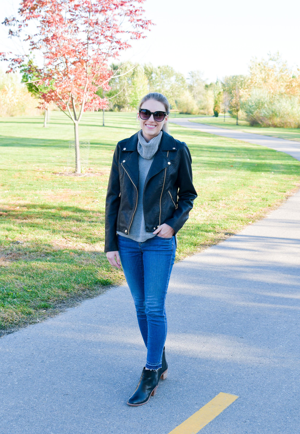 Faux leather jacket fall outfit with sleeveless sweater and chelsea boots — Cotton Cashmere Cat Hair