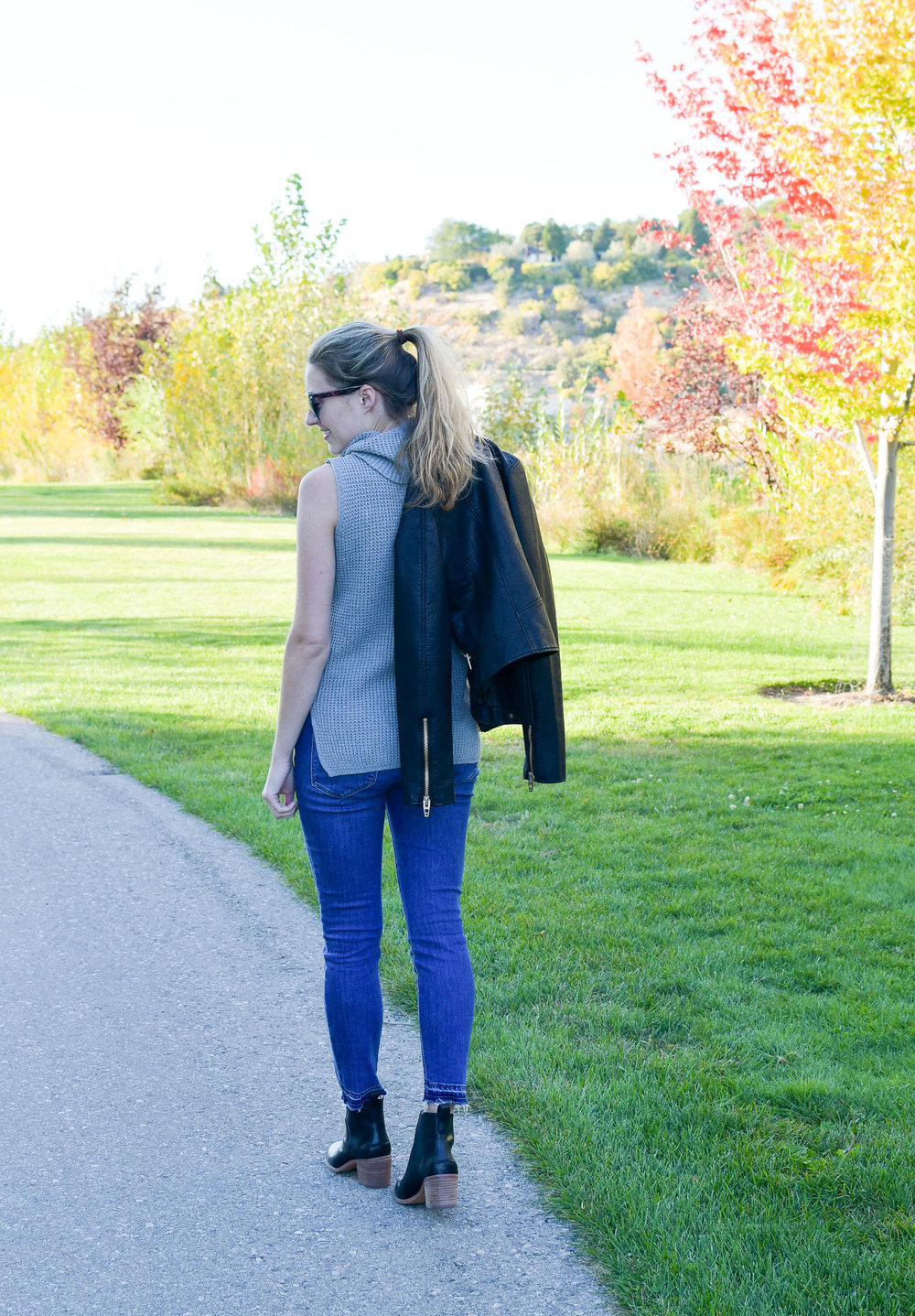 Sleeveless sweater fall outfit with leather jacket and chelsea boots — Cotton Cashmere Cat Hair