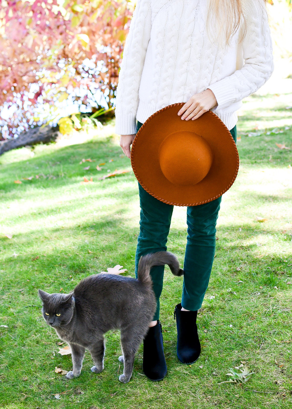 Fall outfit with cable knit sweater and green corduroy pants — Cotton Cashmere Cat Hair
