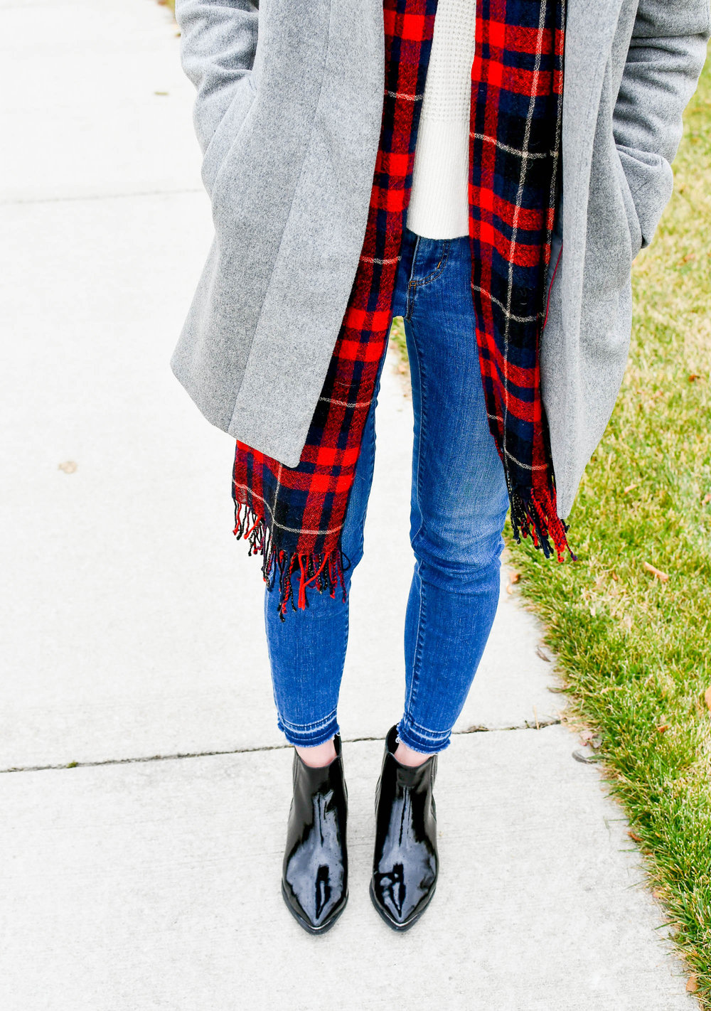 Red plaid scarf, grey coat, patent black boots — Cotton Cashmere Cat Hair