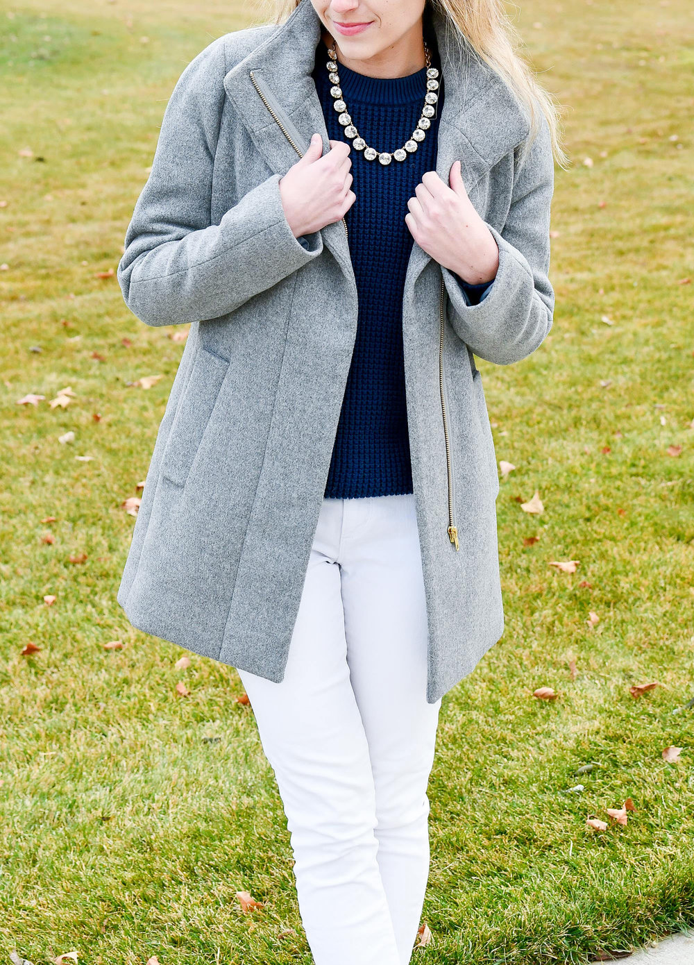 Grey coat outfit with navy sweater and white jeans — Cotton Cashmere Cat Hair