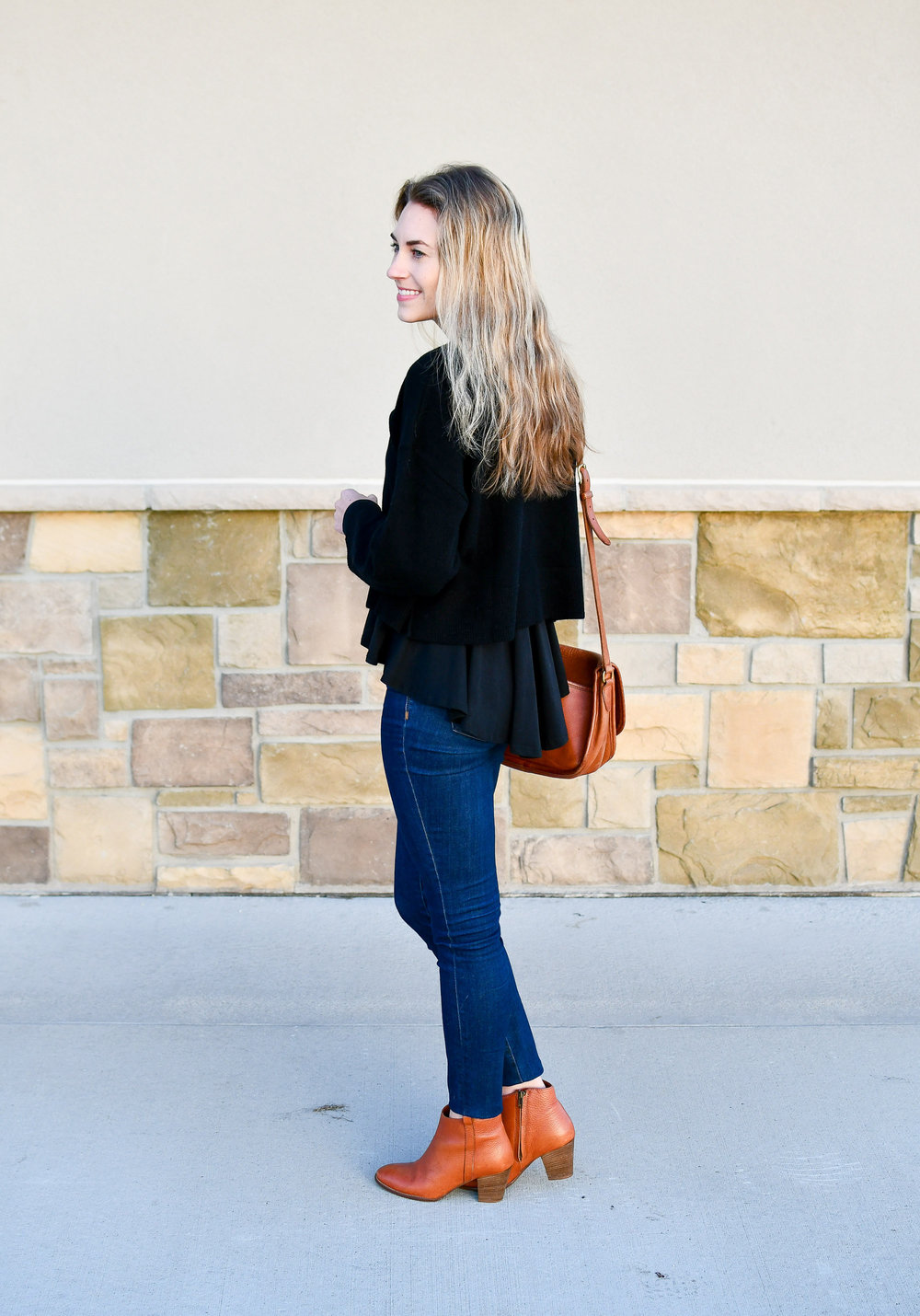 Black sweater layered over peplum top — Cotton Cashmere Cat Hair