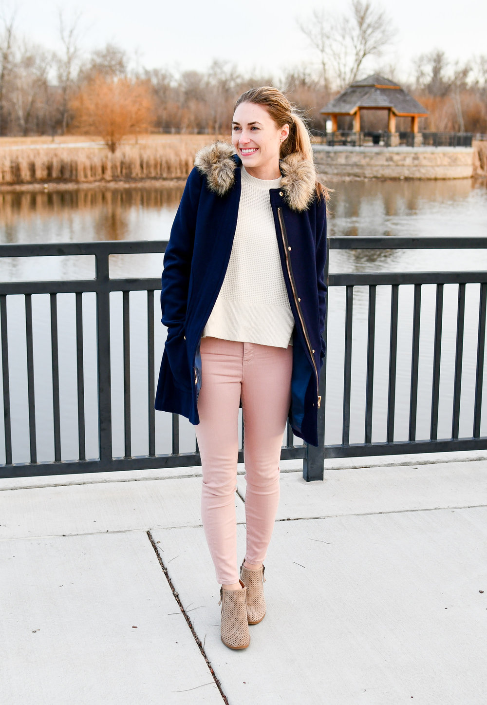 Navy coat winter outfit with pink skinny jeans — Cotton Cashmere Cat Hair