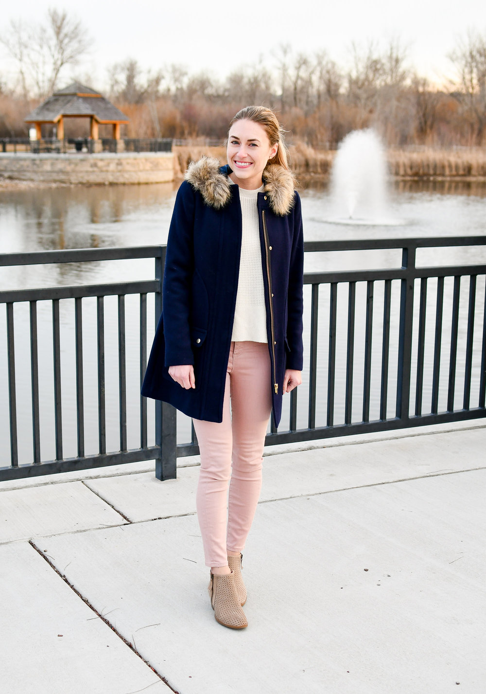 Blush pink jeans, ivory sweater, tan boots, navy coat — Cotton Cashmere Cat Hair
