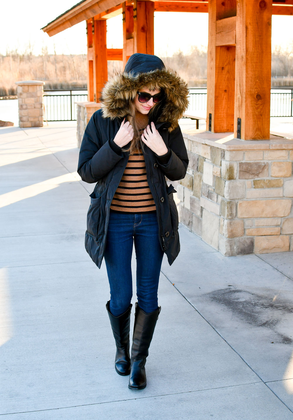 Black puffy parka outfit with striped sweater — Cotton Cashmere Cat Hair