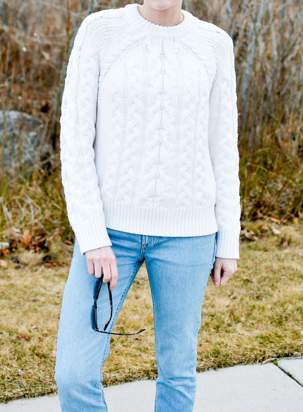Ivory cable knit sweater and light wash boyfriend jeans — Cotton Cashmere Cat Hair