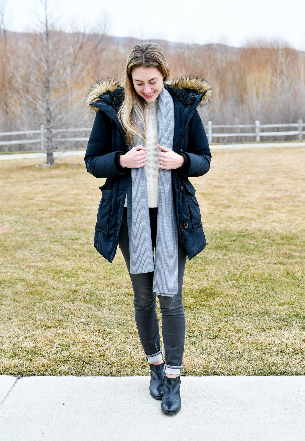 Winter outfit with black parka and grey jeans — Cotton Cashmere Cat Hair