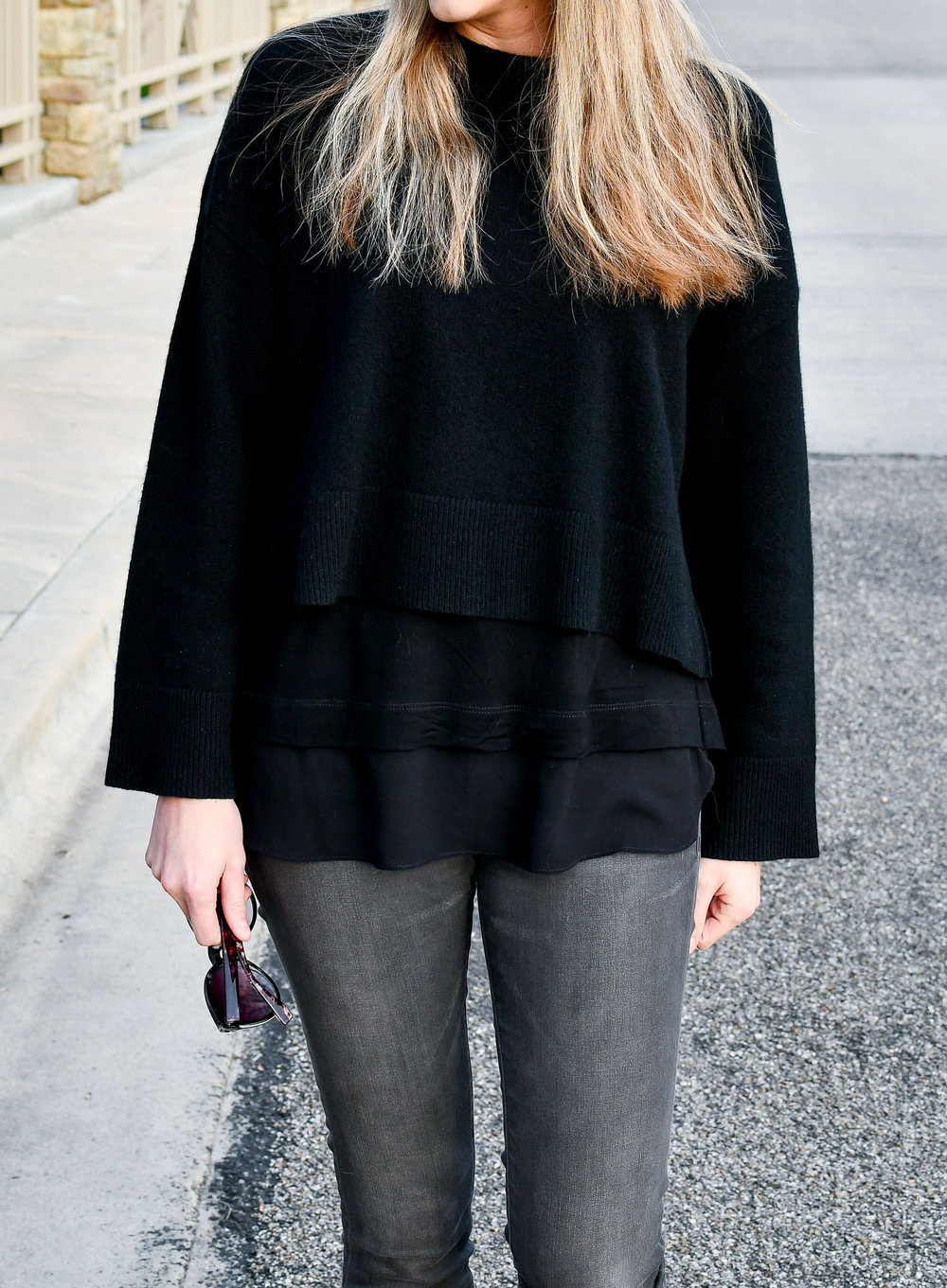 Black cropped sweater over layered top — Cotton Cashmere Cat Hair