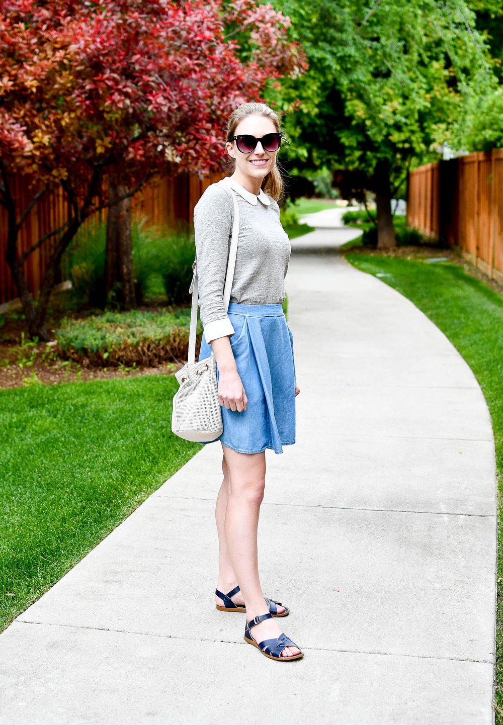 Peter Pan collared top, chambray skater skirt, navy sandals, white bucket bag — Cotton Cashmere Cat Hair