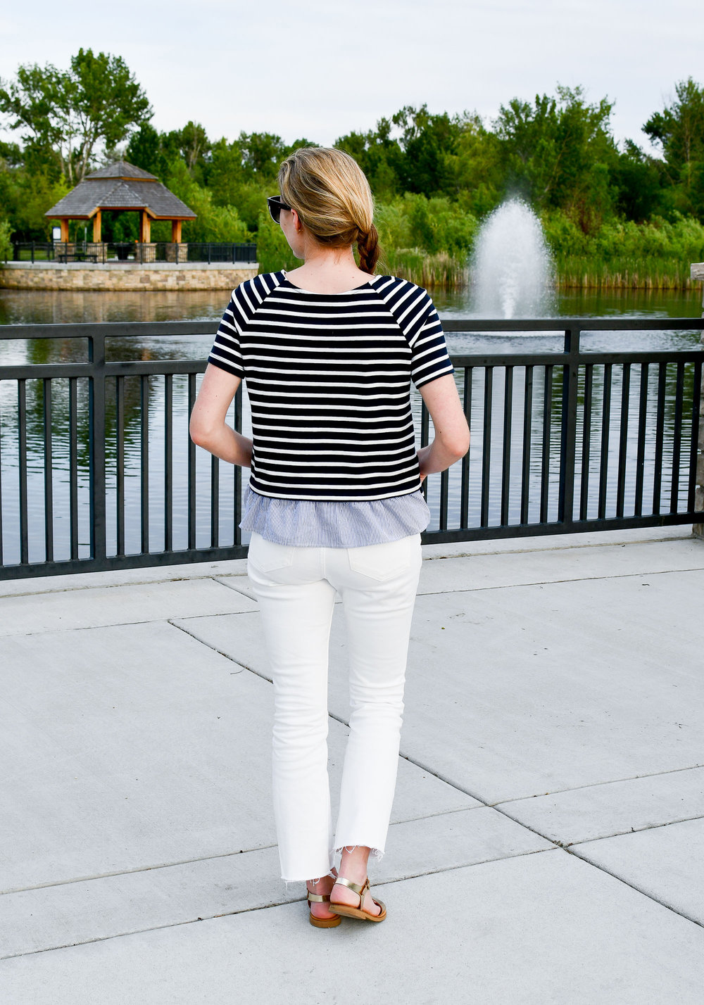 Navy striped top with ruffle and white jeans — Cotton Cashmere Cat Hair