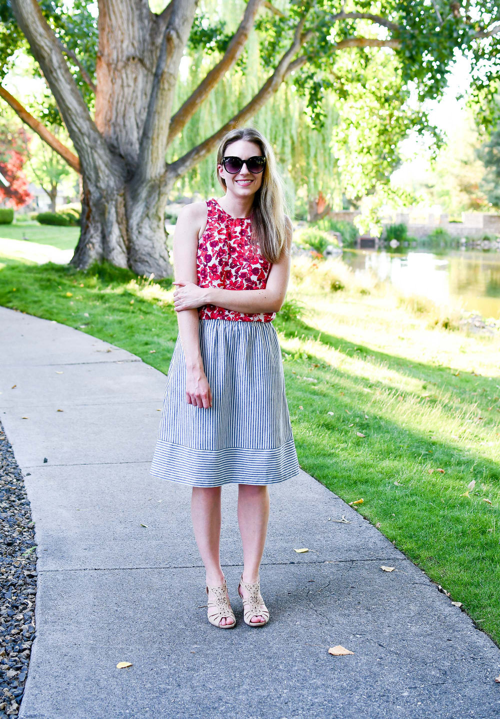 Summer outfit with red floral top and striped skirt — Cotton Cashmere Cat Hair