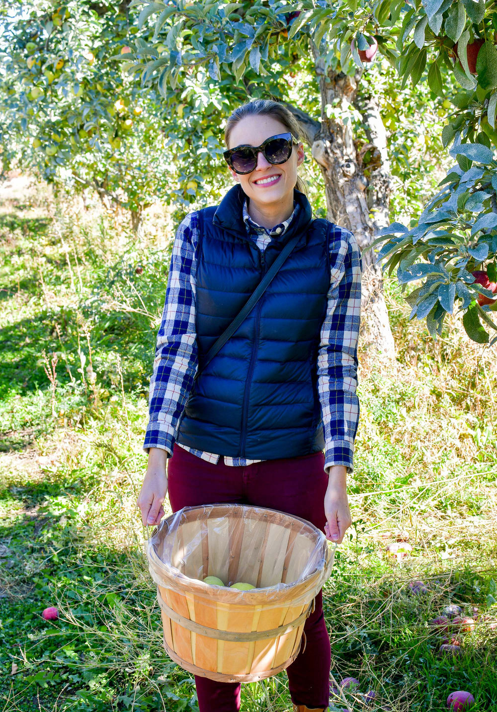 Fall apple picking outfit with plaid shirt and navy puffer vest — Cotton Cashmere Cat Hair
