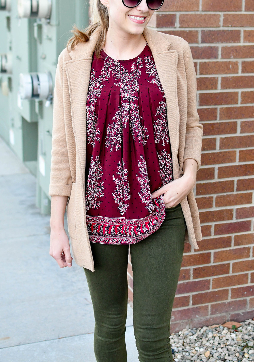 Burgundy top fall outfit with camel sweater blazer and olive jeans — Cotton Cashmere Cat Hair