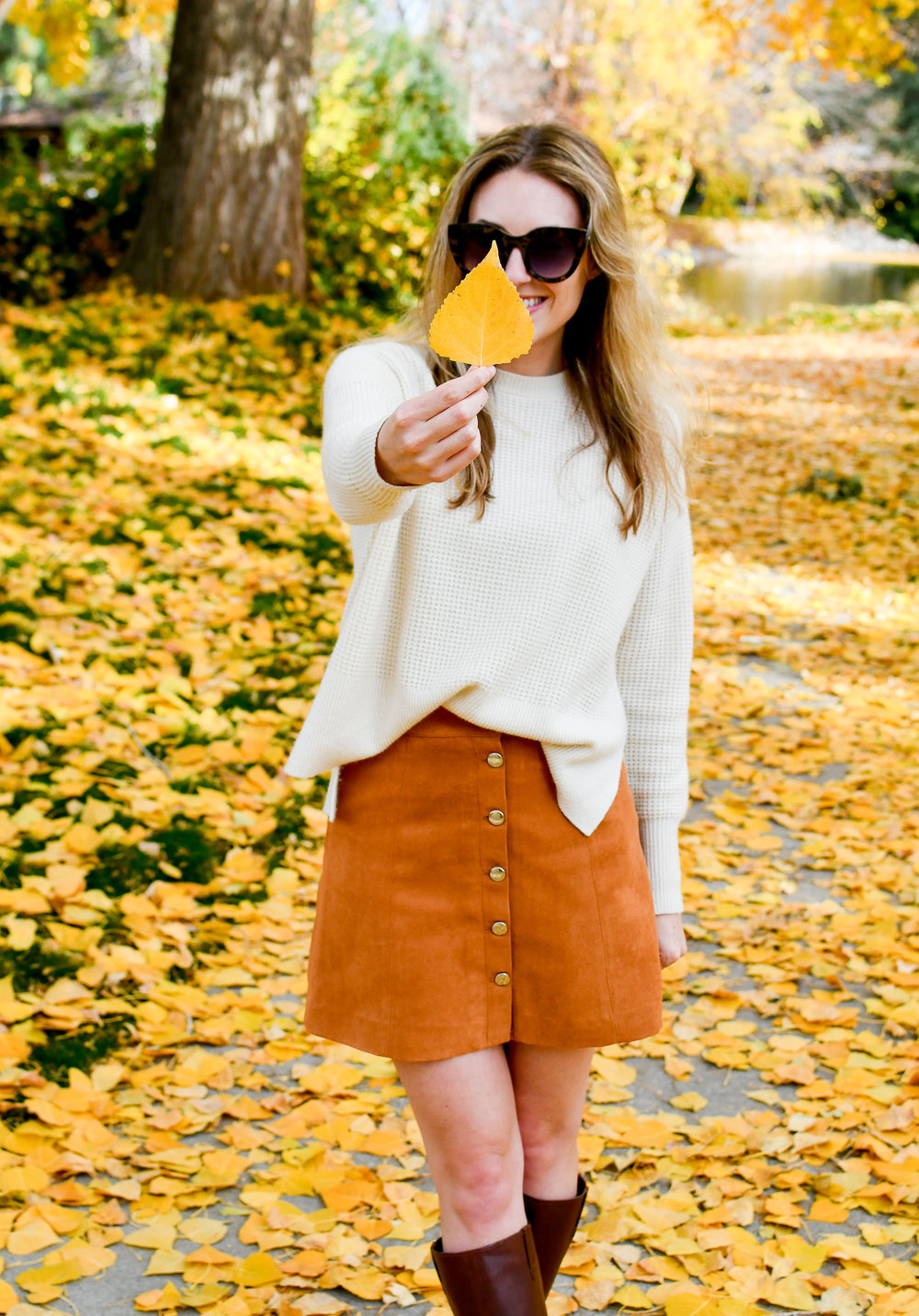 Fall outfit with ivory waffle knit cashmere and camel mini skirt — Cotton Cashmere Cat Hair