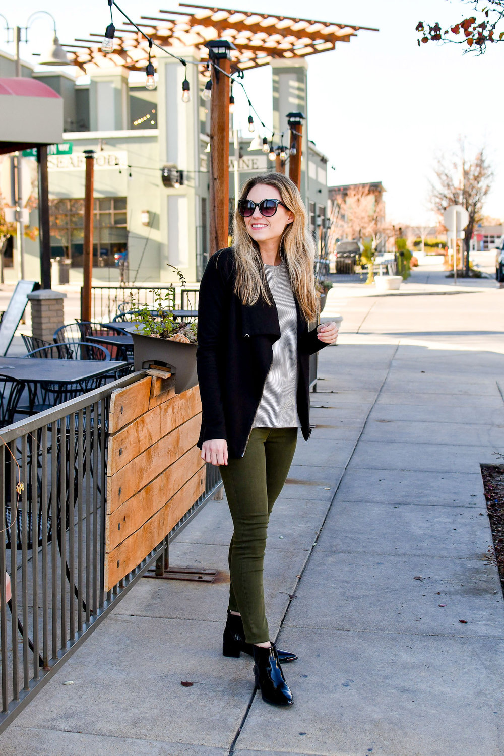 Everlane striped shell, black sweatshirt, olive jeans, black patent boots — Cotton Cashmere Cat Hair