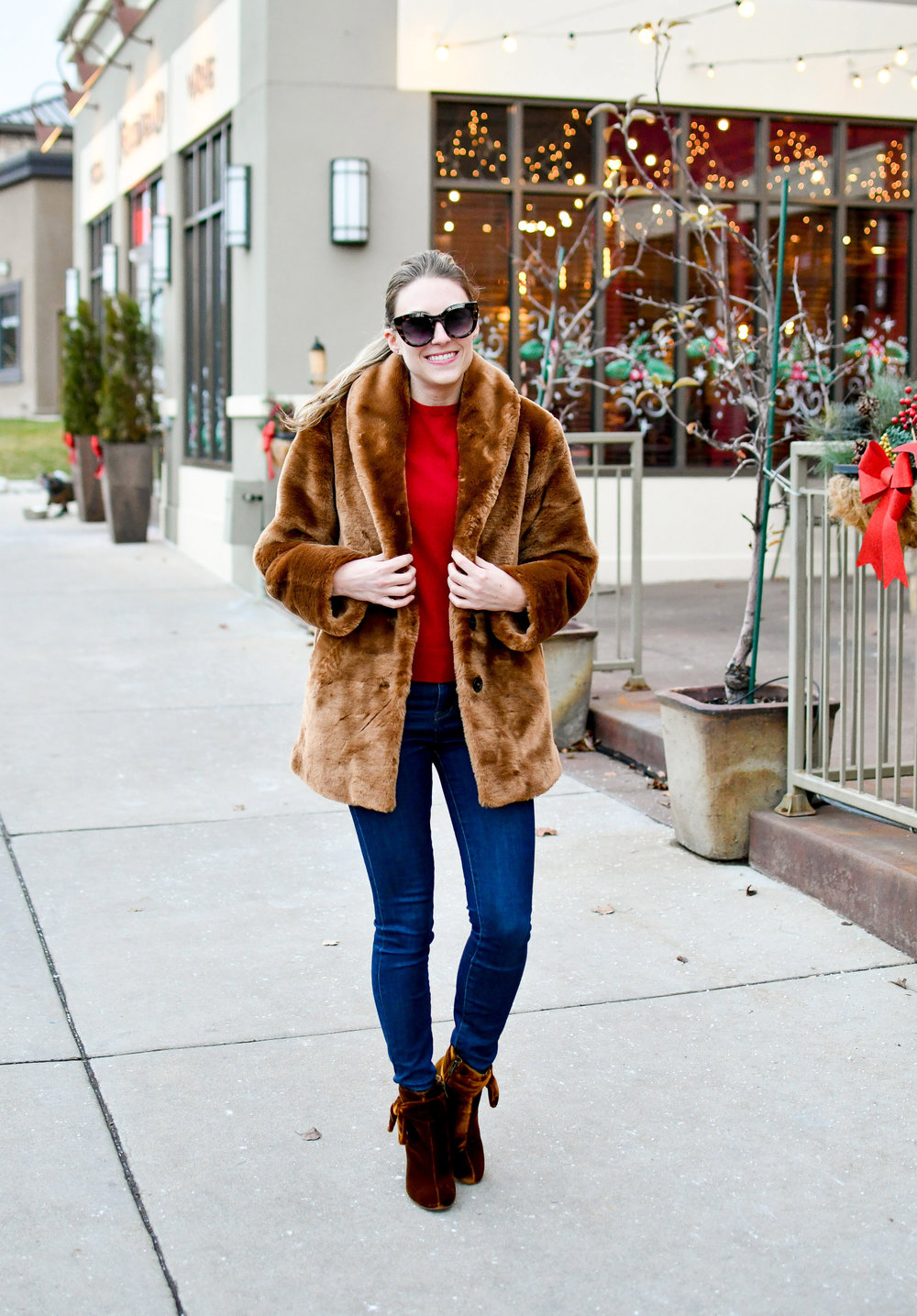 Faux fur coat, red cashmere sweater, velvet bow ankle boots — Cotton Cashmere Cat Hair