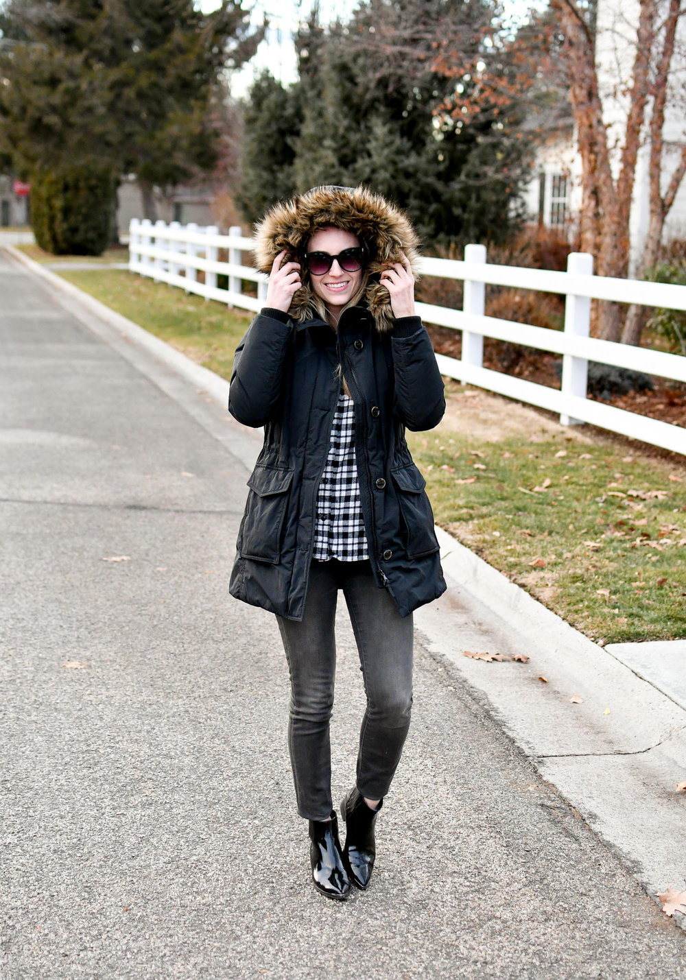 Black parka, plaid shirt, grey jeans, patent leather boots — Cotton Cashmere Cat Hair