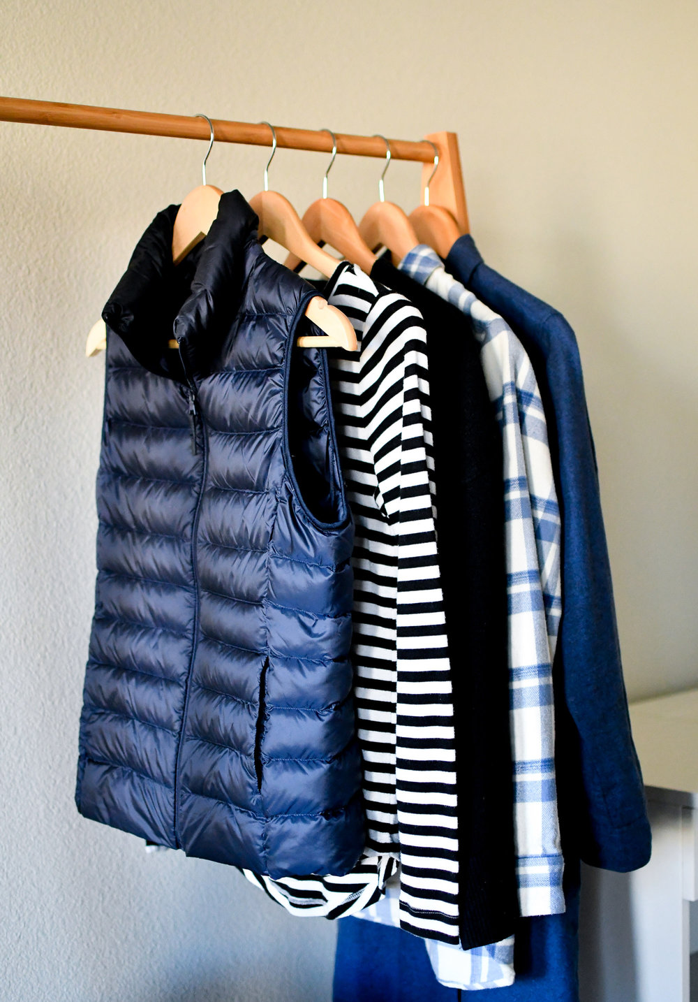 Navy vest, striped tee, flannel shirt — Cotton Cashmere Cat Hair
