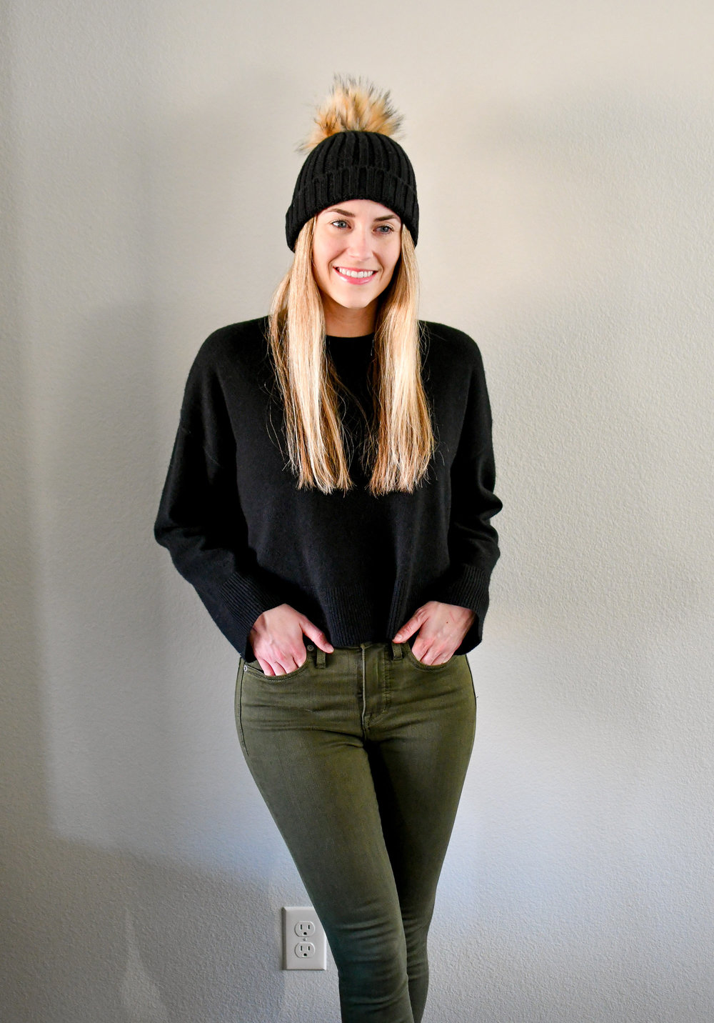 Black cropped cashmere sweater outfit with black beanie and olive jeans — Cotton Cashmere Cat Hair