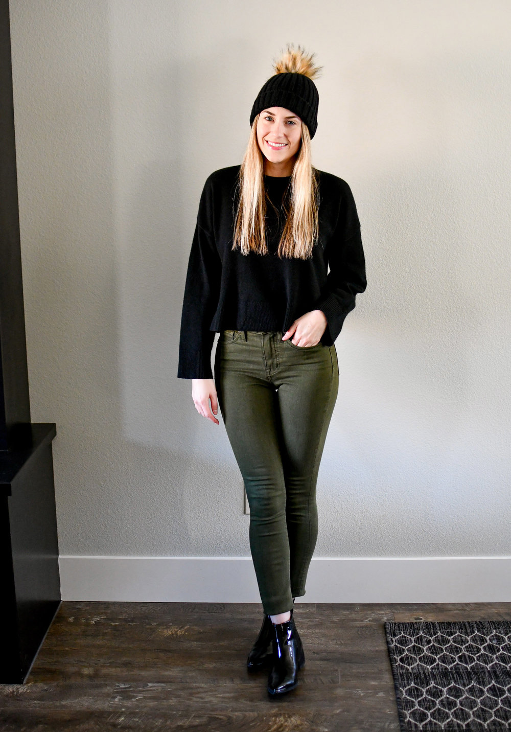 Casual winter outfit with black cropped sweater and olive green jeans — Cotton Cashmere Cat Hair