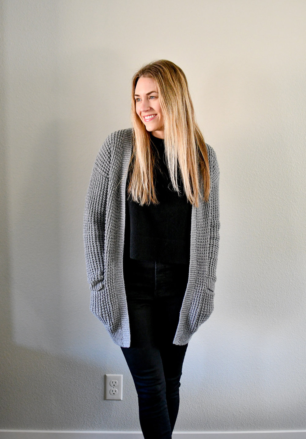 Casual winter outfit with grey cardigan, black sweater, black denim — Cotton Cashmere Cat Hair