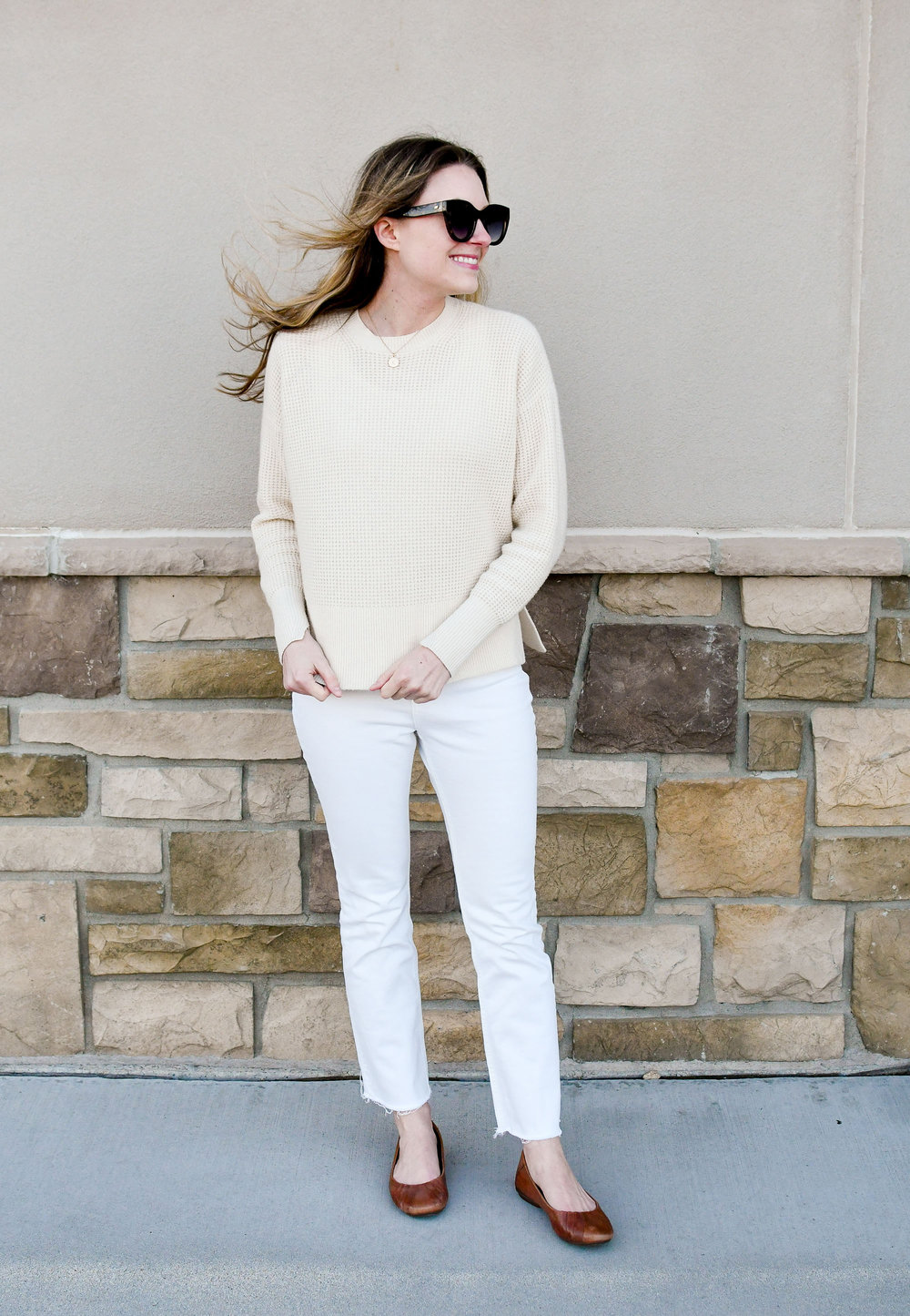 Casual winter whites outfit with ivory cashmere sweater, white denim, brown flats — Cotton Cashmere Cat Hair