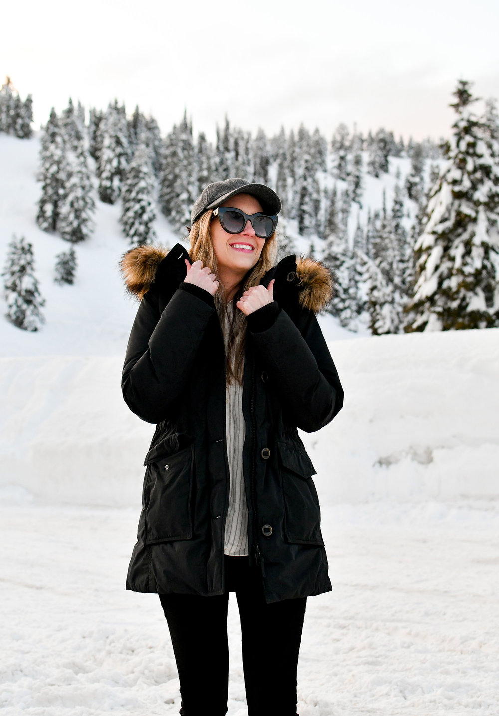 Casual winter outfit with black parka and grey baseball cap — Cotton Cashmere Cat Hair