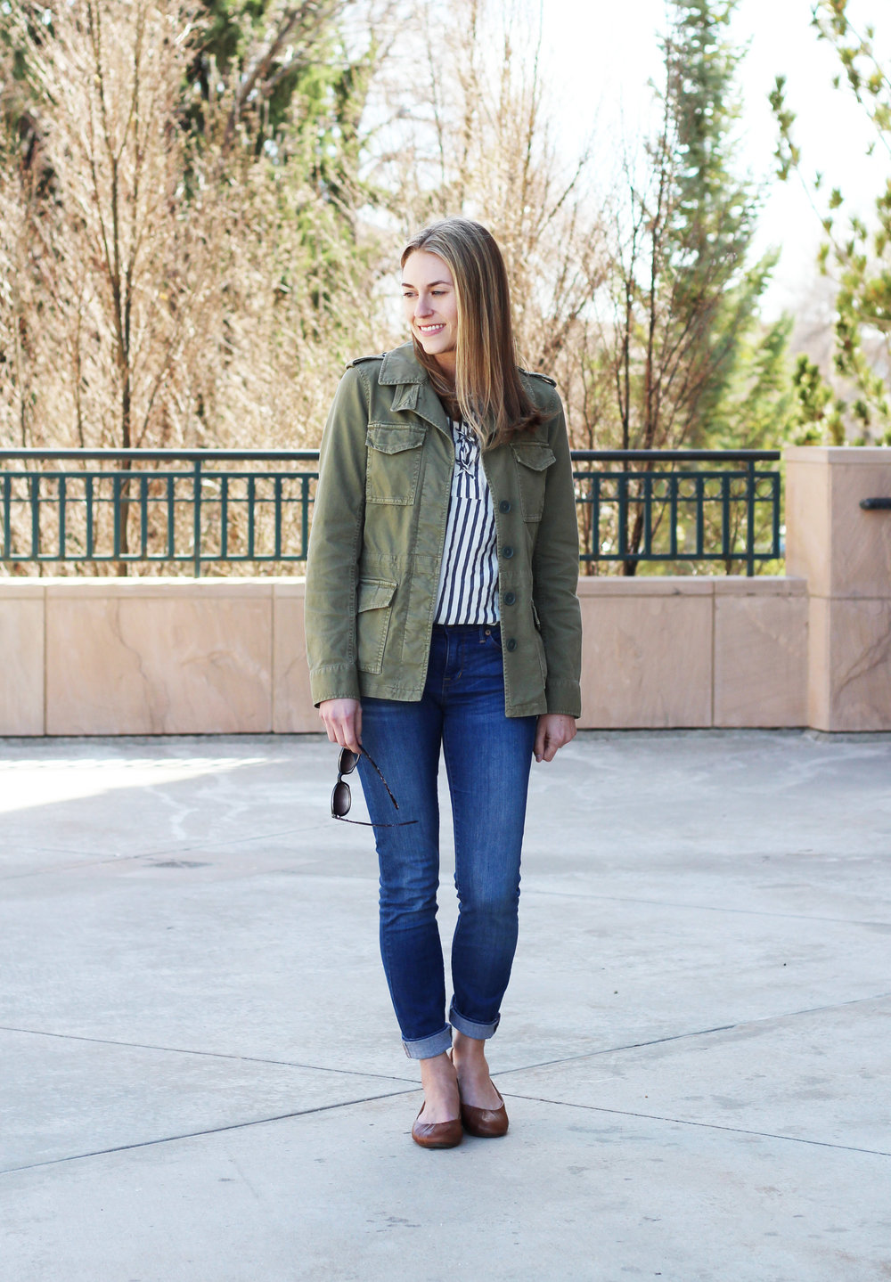 Casual spring outfit with green utility jacket, striped top, brown flats — Cotton Cashmere Cat Hair
